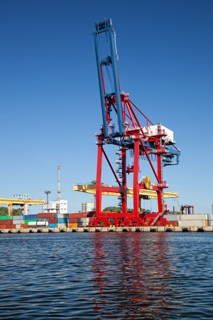 marine industry: Gantry cranes in a harbor on a background of the blue sky.