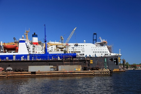 dockyard: A large passenger ship is being renovated in shipyard Gdansk, Poland.