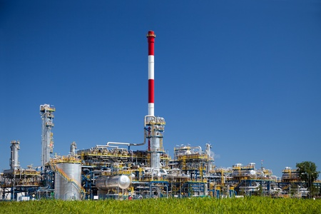 Chemical and oil refinery against blue sky. Stock Photo