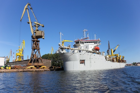 Dredging ship berthed at the wharf port in Gdansk, Poland. photo