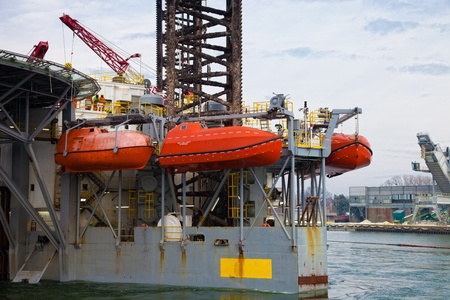 lifeboat: Lifeboats on an oil rig.
