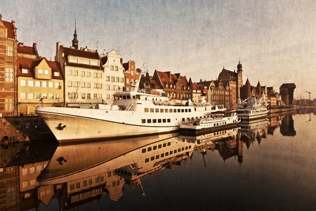 The riverside with the characteristic Crane of Gdansk, Poland. Artistic work of my own in retro style. photo