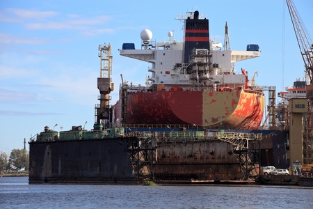 freighter: A large tanker ship is being renovated in shipyard Gdansk, Poland. Stock Photo