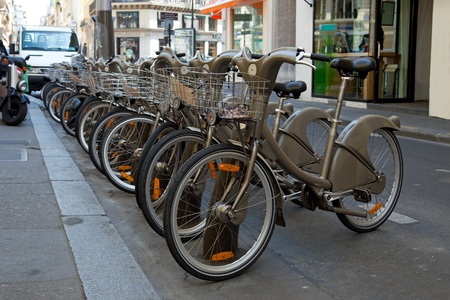 Bikes for rent in the street in Paris, France. photo