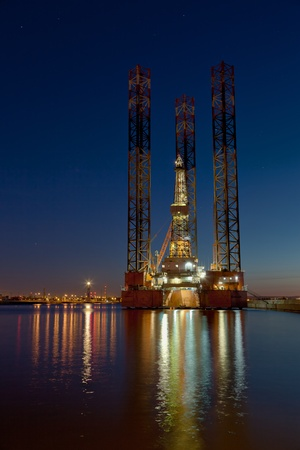 Oil rig at sea in night.