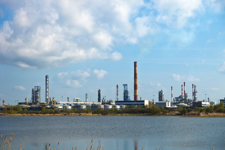 greenhouse gas: Oil-refinery, industrial-plant under blue sky.