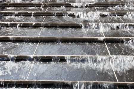 waterfall in the city: Water encroaching on the stairs.