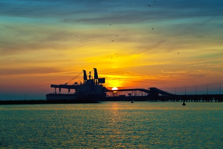 Coal pier at sunrise in port of Gdansk, Poland. Stock Photo