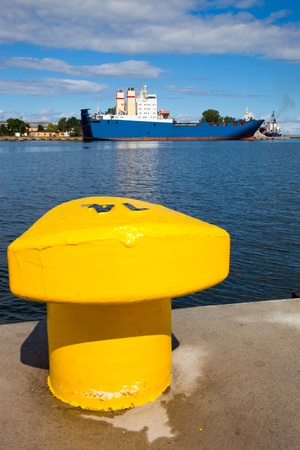 Bitts yellow against a background of moored ship. Gdynia, Poland.  photo