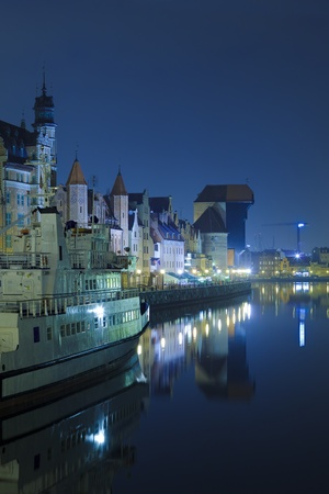 The quays with the characteristic medieval crane of Gdansk, Poland.