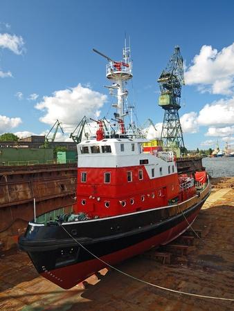 gdansk: Fire-boat in floating dry dock. Gdansk, Poland.