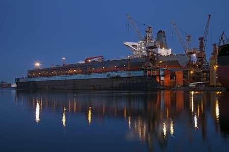 dockyard: A large tanker ship is being renovated in shipyard Gdansk, Poland
