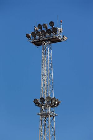 Lighting tower against a clear blue sky  photo