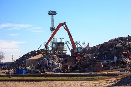 grabber: Mechanical crane grabber working in a scrapyard  Editorial