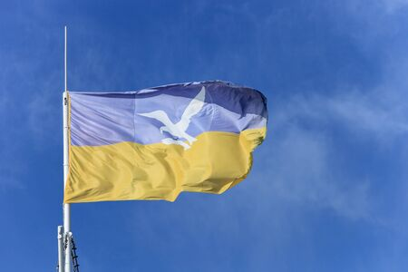 Flag of Sopot on blue sky, Poland   Stock Photo - 13592590