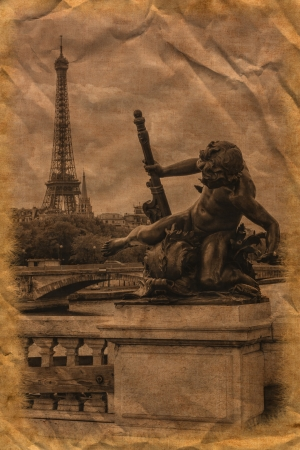 Statue of a cherub on the Alexander III bridge in Paris with the Eiffel Tower on background  photo