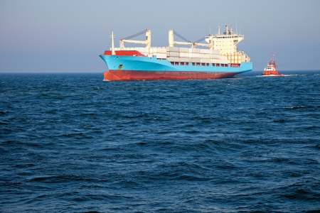 tug boat: Container ship assist by a tugboat towards the port of Gdansk.