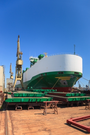 ferrying: Ship vehicle carrier during the renovation of the shipyard in Gdansk, Poland  Stock Photo