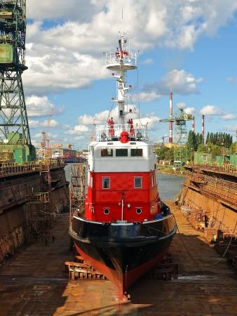 Fire-boat in floating dry dock  Gdansk, Poland  photo