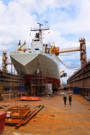 shipper: A large cargo ship is being renovated in shipyard Gdansk, Poland.