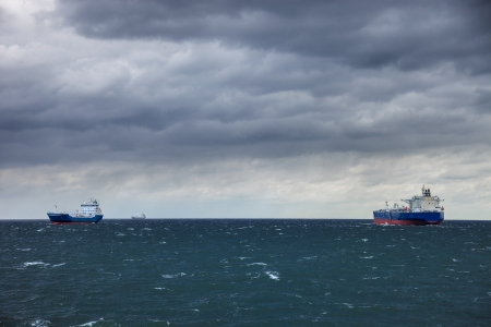 bad weather: Two ships at sea and the upcoming storm  Stock Photo