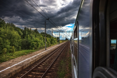 Dark rain clouds accompanying the train  photo