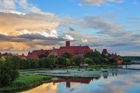 templars: The Marienburg Castle in Malbork on the right bank of the Nogat, is the largest castle in the world by surface area, and the largest brick building in Europe.  Editorial