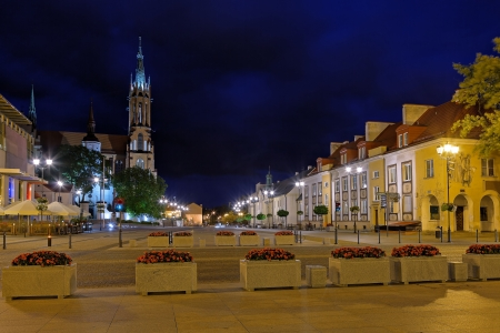 time square: City at Night on the left side of the cathedral of Bialystok, Poland