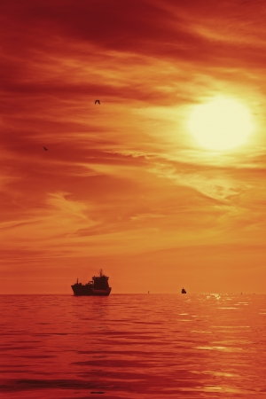 Ship in the beautiful sunset on the sea  photo