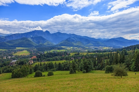 A view of The Tatra Mountains and village in summer, Poland  photo