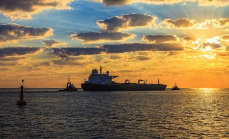 Solar Convoy - Tanker at sunset putting out to sea  photo