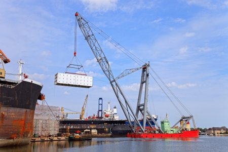 Heavy lifting floating crane vessel during operation