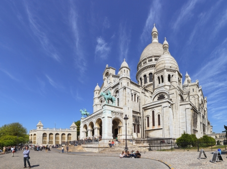 The Basilica of Sacre Coeur in Paris, France. Basilica is a famous catholic church in Paris. It is located at the highest point in the city. Photo taken on: May 19th, 2010