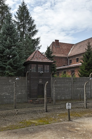 Auschwitz I, a former Nazi extermination camp in Poland with exterior buildings, watch tower and barbed wire fence.  Photo taken on: August 15th, 2012