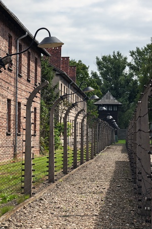 nazism: Auschwitz I, a former Nazi extermination camp in Poland with exterior buildings, watch tower and barbed wire fence.  Photo taken on: August 15th, 2012 Editorial