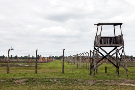 extermination: Auschwitz II-Birkenau, a former Nazi extermination camp in Poland. This photo show the multiple electric fence and guard tower. Photo taken on: August 15th, 2012  Editorial