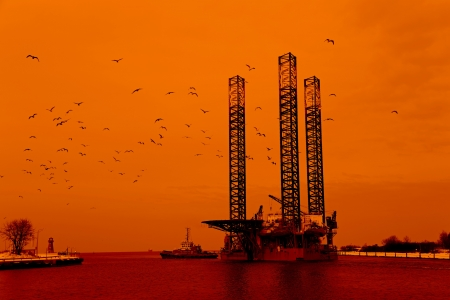 Oil rig at sunset background  photo