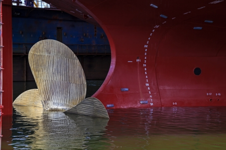 hull: Close up of a Ship Propeller in water