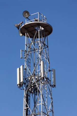 Detail of transmitter tower against a clear blue sky  photo