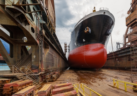drydock: A large tanker ship is being renovated in shipyard Gdansk, Poland