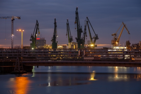Big cranes and bridge at the shipyard at night  photo