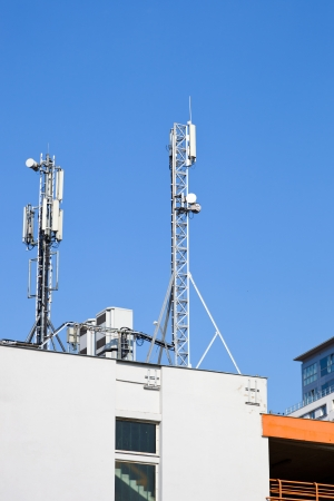 telecommunication equipment: Transmitter over blue sky for mobile connection  Stock Photo