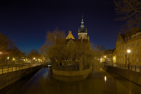 Channel Raduni flowing with a Great Mill in Gdansk, Poland  photo