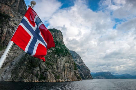 The flag flow on the cruise in Norwegian fjord