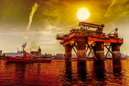 Oil rig in the dramatic scenery  photo