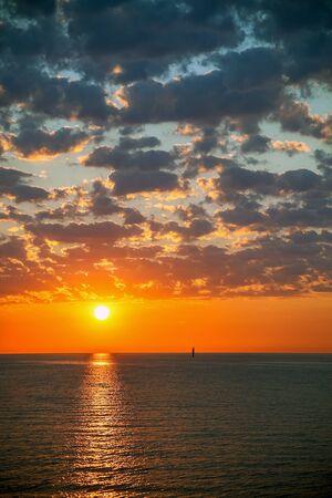 over the sea: Colored sunrise over the sea  Stock Photo