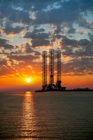 oil and gas industry: Sea oil rig on sunrise