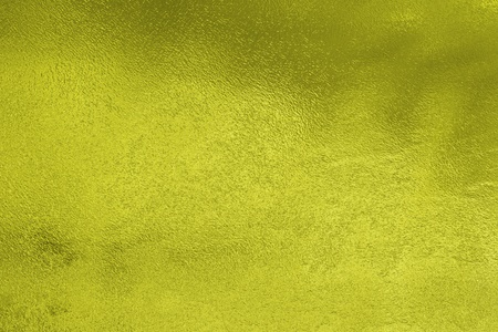 water stained: Yellow stained glass with light and dark reflections