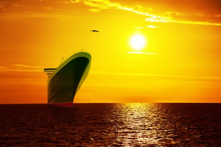 Big ship on sunrise in the sea  photo