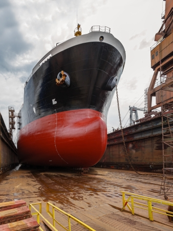 hull: A large tanker ship is being renovated in shipyard Gdansk, Poland